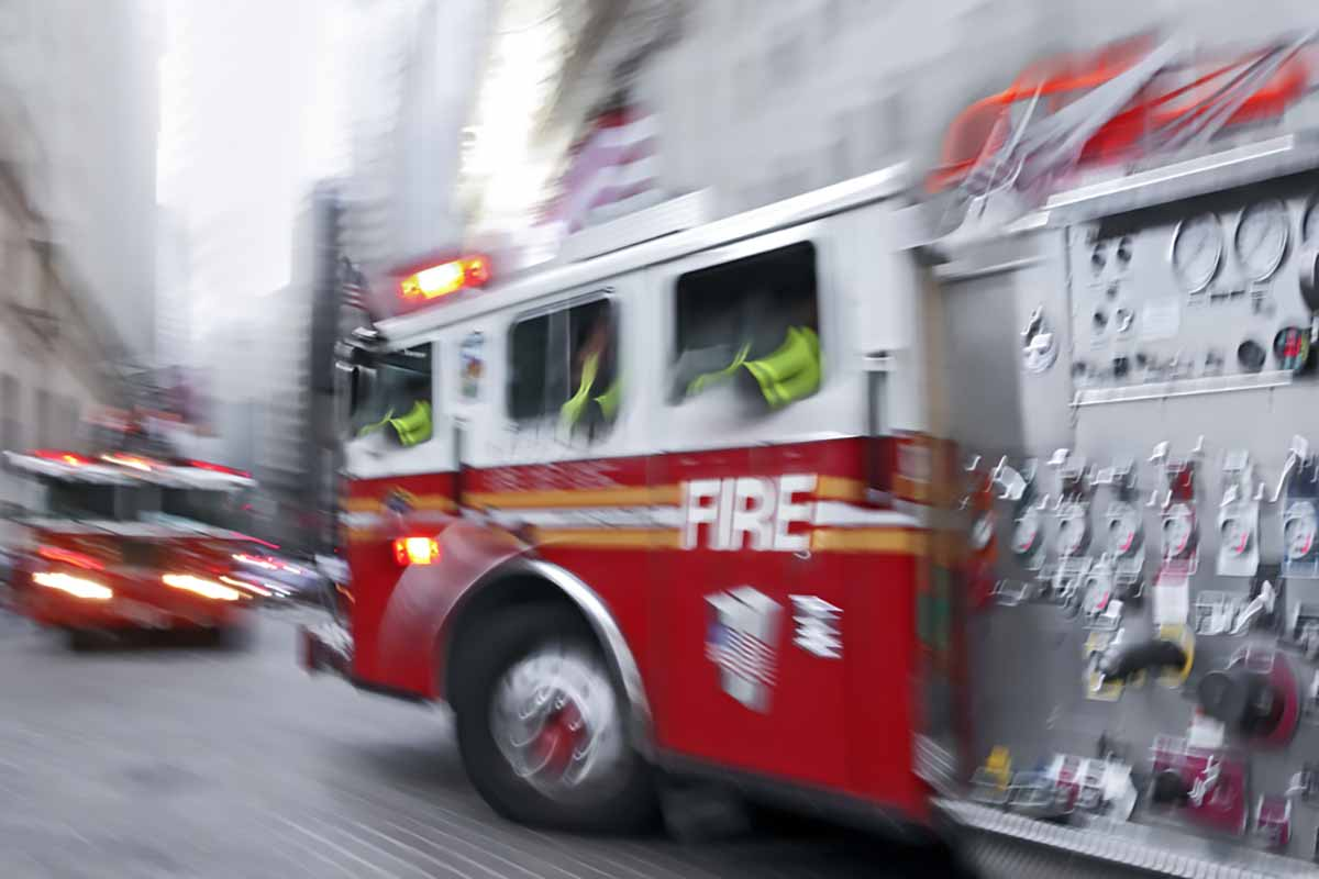 Fire truck in motion with lights on.