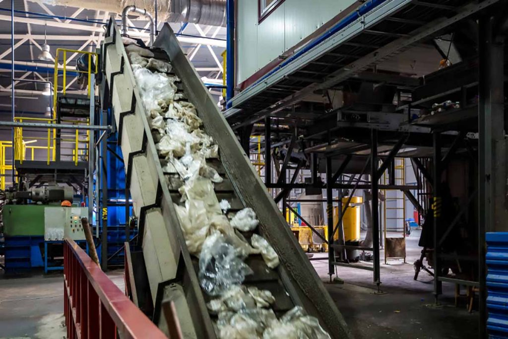 Materials on a conveyor at a MRF.