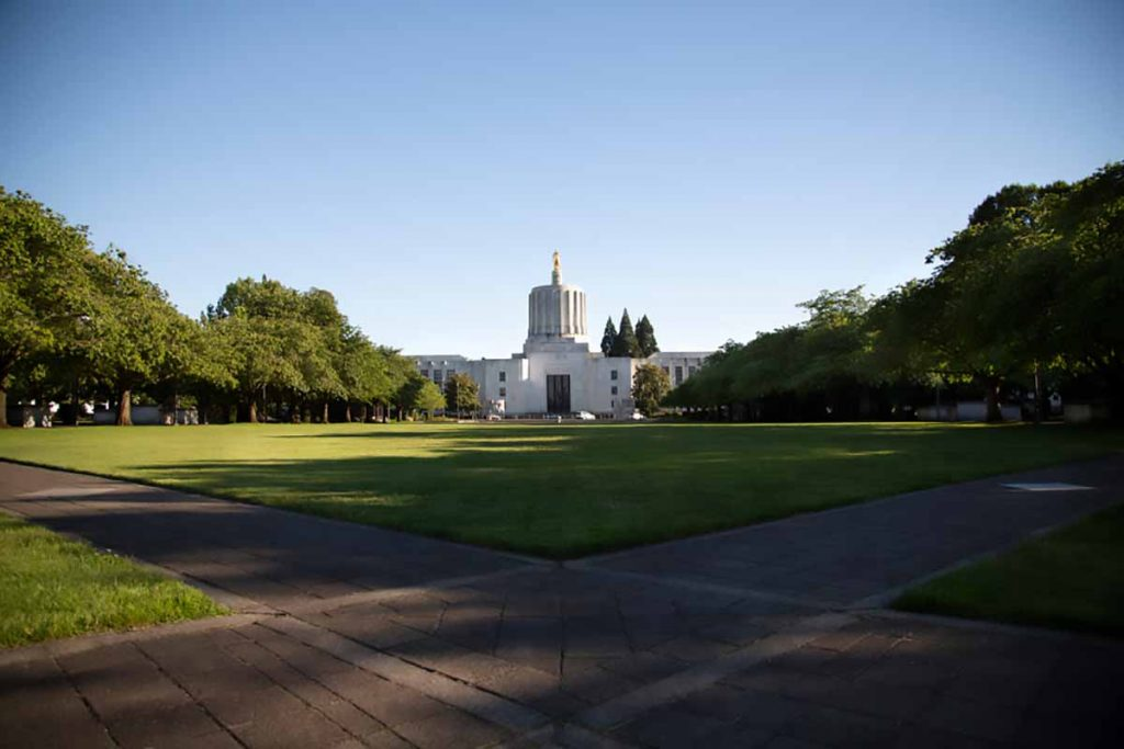 View of the Oregon captial building with greenspace in front.